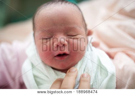 new born baby smiling for his mother  first day
