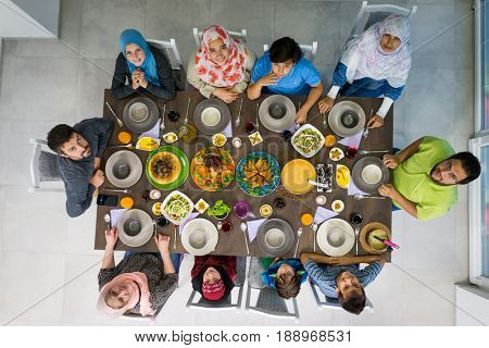 Top view of Muslim family gathering for eating iftar food in Ramadan