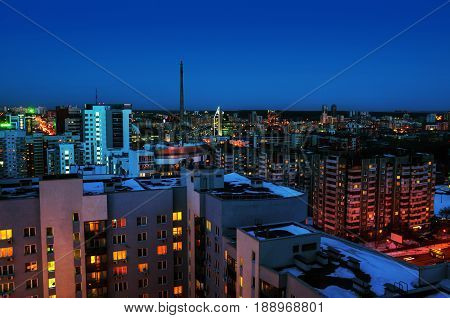 Yekaterinburg, Russia. Aerial view of downtown in Yekaterinburg, Russia at night. Beautiful sunset over the city with dark blue sky