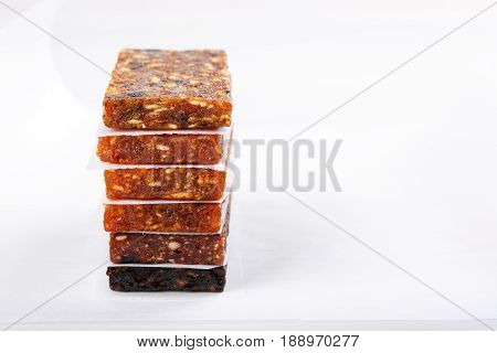 Fruit berry and nut energy bars. Healthy snack. Copy space
