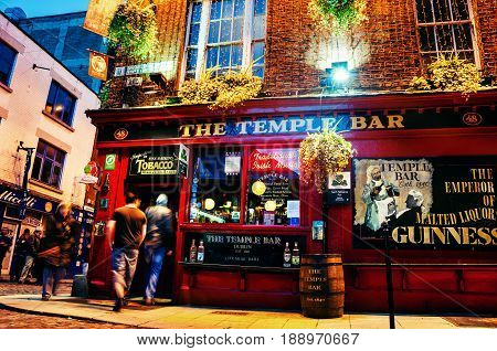 DUBLIN, IRELAND - NOVEMBER 11, 2014: Nightlife at popular historical part of the city - Temple Bar quarter in Dublin, Ireland. The area is the location of many bars, pubs and restaurants