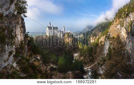 Fairytale Neuschwanstein castle panorama in the mountains