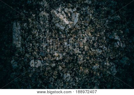 Experimental stone texture and background. Dark rough rock texture. Abstract texture and background for designers. Macro view of dark rough rock floor in vintage style.