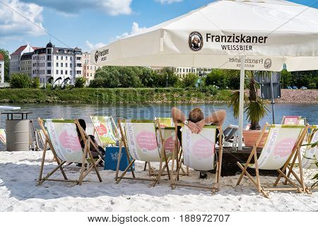 MAGDEBURG, GERMANY - MAY 20, 2016: beach bar on the banks of the river Elbe in Magdeburg. The beach bar is one of the most popular tourist destinations in the summer