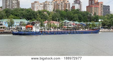 Rostov-on-Don Russia - May 282017: On the Don River sailing freighter. On the waterfront walk people