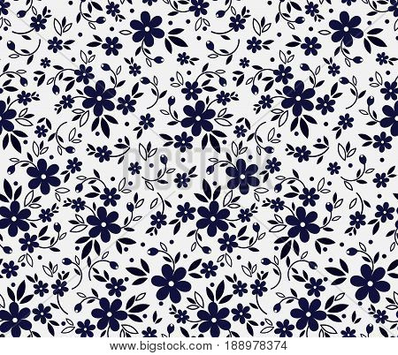 Vector seamless pattern. Cute pattern in small flower. Small navy blue flowers. White background. Ditsy floral background. The elegant the template for fashion prints.