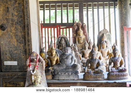 Buddha images inside Ho Trai or the library of Buddhist scriptures (Tripitaka or Pali Canon) located at Wat Mahathat Temple in downtown Yasothon northeastern (Isan) province of Thailand poster