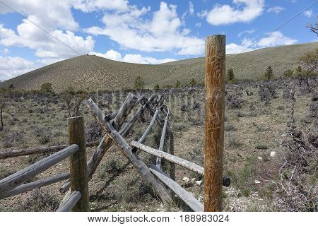 Rustic rail fence in foothills near trailhead to climb Mt. Borah, Idaho's tallest peak.
