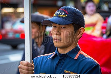 KYOTO, JAPAN - NOVEMBER 11, 2016: November parade on the street of Gion in Kyoto. Kyoto was formerly the Imperial capital for more than one thousand years and one of the most populous cities in Japan.