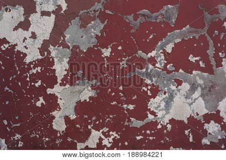 Old weathered damaged red wall texture.