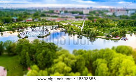 Aerial view of Tsritsyno lake with a fountain - Moscow city in Russia. Tilt-shift effect applied.