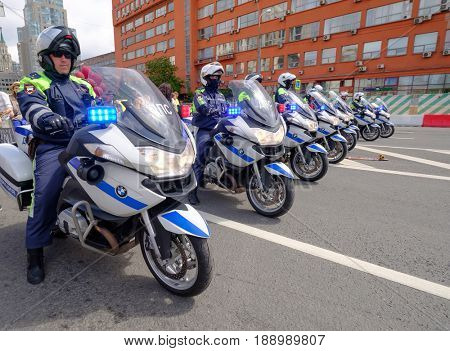 Moscow, Russia - May 28, 2017: Motorcade of police motorcyclists is accompanied by a bicycle parade
