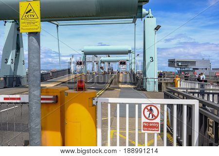 Cardiff Bay Wales - May 21 2017: Barrage openinng to let the pedestrians cross. Shows lights and control building.