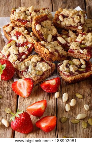 Granola Bars With Strawberry Jam, Seeds And Nuts Close-up. Vertical