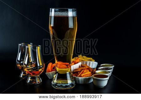 Set Of Snacks With Different Dips, Single Malt In A Glass And Pint Of Beer, Crunchy Snacks In A Bowl