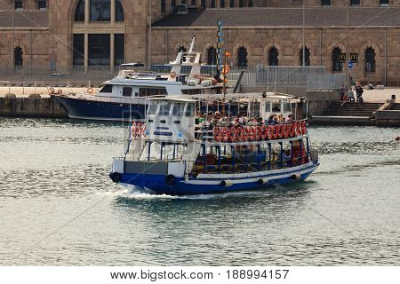 BARCELONA, SPAIN- APRIL 16: people on the tourist boat in barcelona port on april 16, 2013 in Barcelona