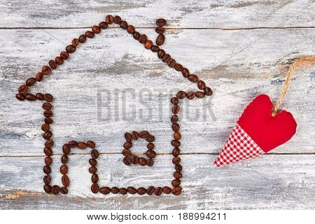 Coffee beans and textile heart. Coffee house on wooden bakground.