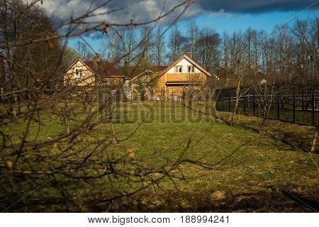 Country Houses With A Garden Of Fruit Trees In Springtime
