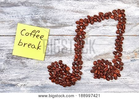 Coffee break message and coffee. Melody from coffee beans.