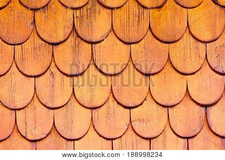 Pattern of wooden shingles of outside wall siding of Black Forest house Germany central Europe