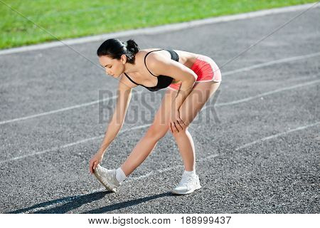 Full Body Of Girl Warming Up Before Running