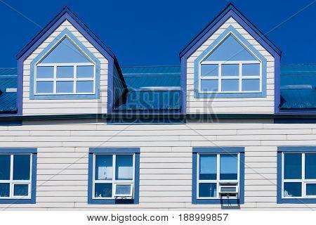 Wooden Frame House Blue Metal Roof Dormer Windows