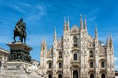 The famous Milan Cathedral (Duomo di Milano) and monument to Victor Emmanuel II on the Piazza del Duomo in Milan, Italy. Milan Duomo is the largest church in Italy. poster