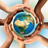 Conceptual symbol of multiracial human hands surrounding the Earth globe. Unity, world peace, humanity concept. poster