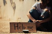 Poor woman begging for help on the  street poster