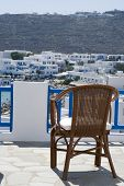 greek island view of beach and cyclades architecture from hotel suite patio poster