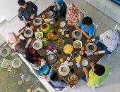 Top view of Muslim family gathering for eating iftar food in Ramadan poster