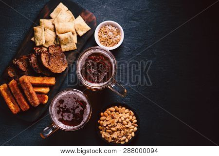 Beer And Snacks. Bar Table. Restaurant, Pub, Food Concept. Delicious Lager Drink And Appetizers Set-