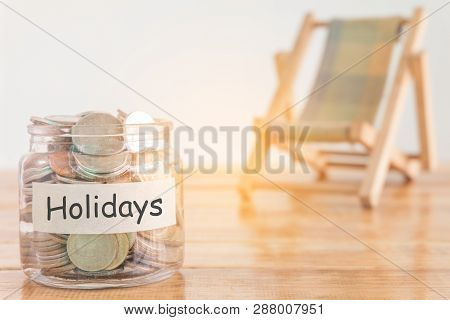 Holidays Budget Concept. Holidays Money Savings Concept. Collecting Money In The Money Jar For Holid
