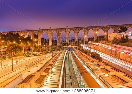 View of The Aguas Livres Aqueduct and Campolide train station, Lisbon, Portugal poster