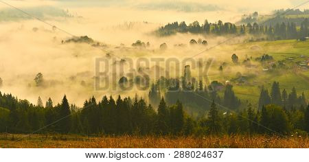 Misty Countryside. Panoramic Rural Landscape With Misty Autumn Forest In Mountains