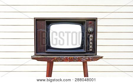 Old Retro  Wooden Home Tv Receiver  On Old Wood Table On White Wood Wall/ Old  Television On Old Tab