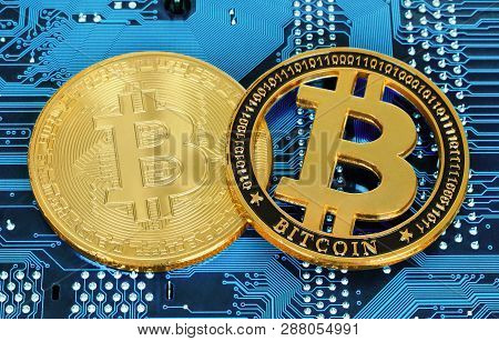 Bitcoin Cryptocurrency Coins On Circuit Board Background Close-up