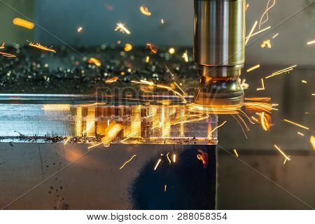The  Hot Chip On Cnc Machine From Tool Wear. The Cnc Milling Machine Cutting The Mold Part With The