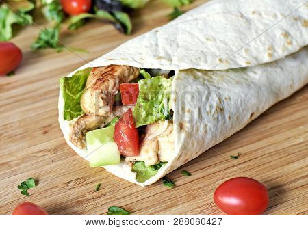 Delicious Fresh Chicken Wrap, Closeup Shot. Tasty Tortilla With Salad And Turkey Meat,healthy Eating