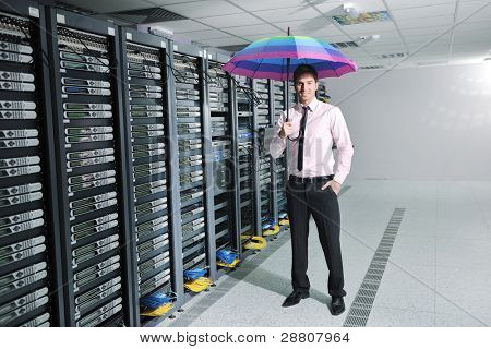 poster of young handsome business man  engineer in .businessman hold  rainbow colored umbrella in server datacenter room  and representing security and antivirus sofware protection concept
