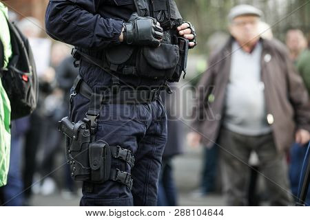Details Of The Security Kit Of A Riot Police Officer (including Handcuffs, 9mm Handgun, Radio Statio