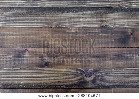 Brown wooden background with visible texture