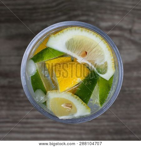 Sparkling water with lemon top view