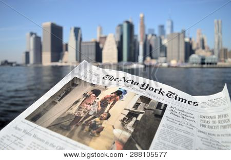 New York City, Usa - February 3, 2019: The New York Times Newspaper Against A Lower Manhattan Skylin