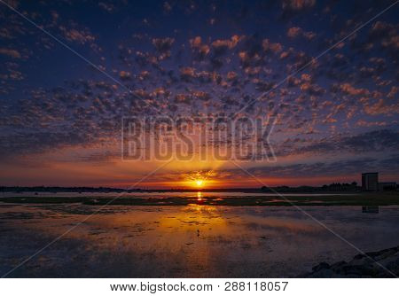 Crepuscular Rays And Cirrocumulus Clouds Create A Spectacular Sunset Over Holes Bay, Poole Harbour,