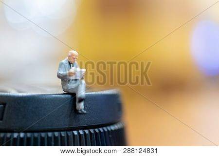 Miniature People : Businessman Reading A Book And Copy Space For Text