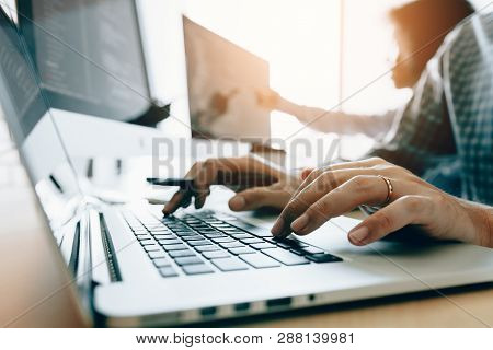Close Up Of Hands Contemporary Website Developer Man Typing And Writing Code For Program Website And