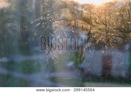 dirty glass windows with frost in the daytime poster