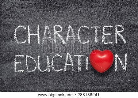 Character Education Phrase Handwritten On Chalkboard With Red Heart Symbol Instead Of O