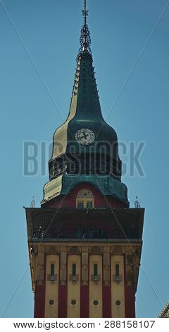 Top Of The Tower With A Clock On A Catholic Church
